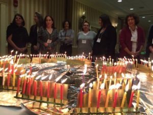 Lighting Chanukah candles at the DSLTI alumni retreat